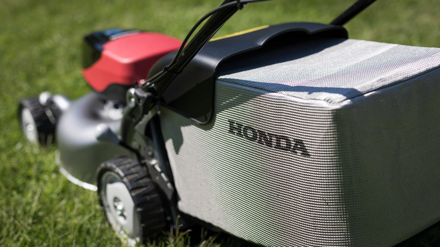 Rear three quarter view of grass cutting bag.