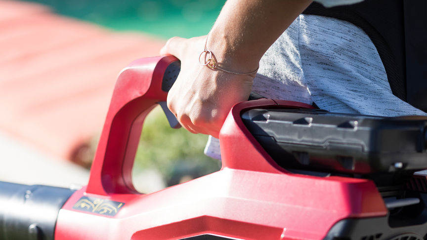 Close up of Honda cordless leafblower adjustable speed control.