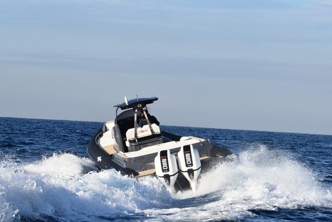 Front three-quarter facing boat with Honda marine engine.