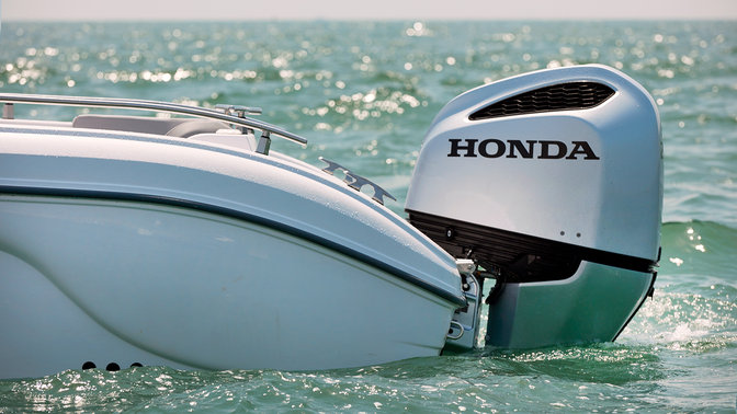 Side facing boat with Honda marine engine.