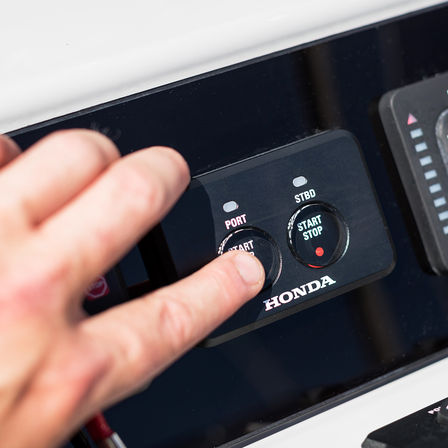 Close up of Honda marine engines start stop buttons.